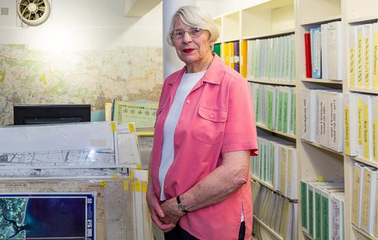A photo of a volunteer in the research room at The Spring Arts and Heritage Centre