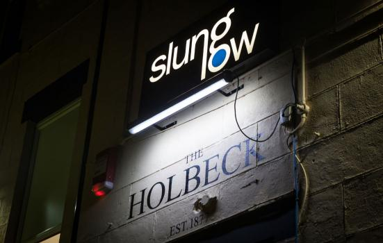 Photo of neon sign that says Slung Low at The Holbeck