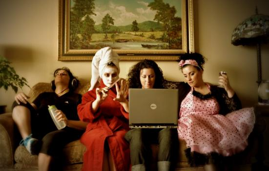 Photo of people on sofa with laptop