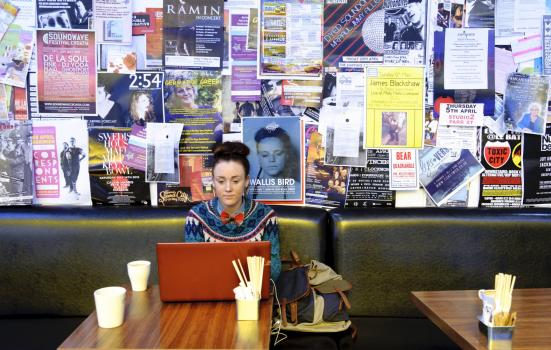 Photo of woman with laptop in cafe