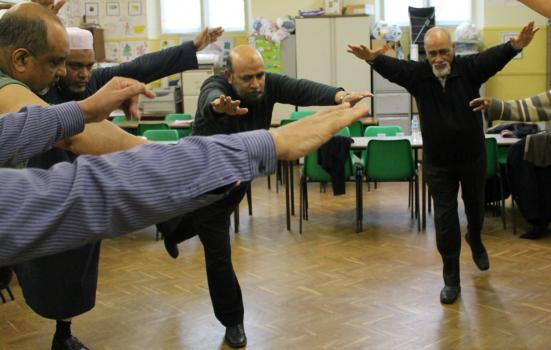Photo of men dancing