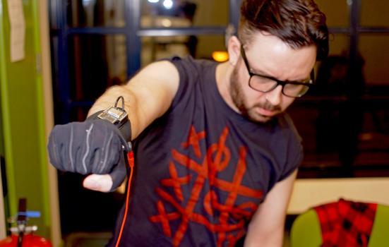Photo of musician testing glove