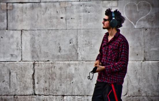 Photo of man on street with headphones