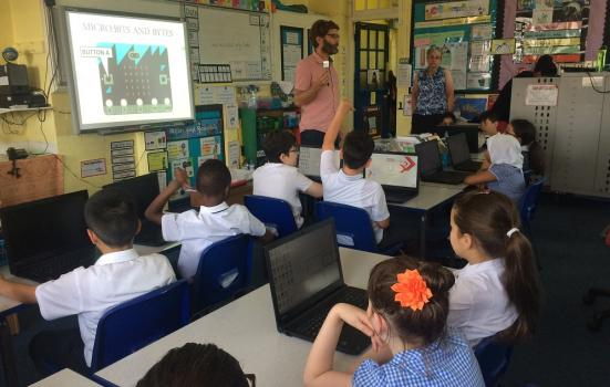 Photo of Julian Mitchell leading a coding activity at Raynham Primary School in London