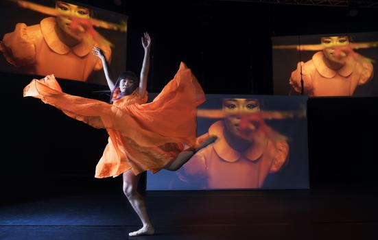 Photo of dancer with screens in background