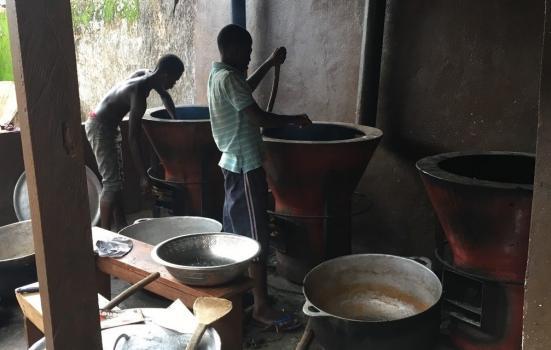 Photo of children stirring big pots