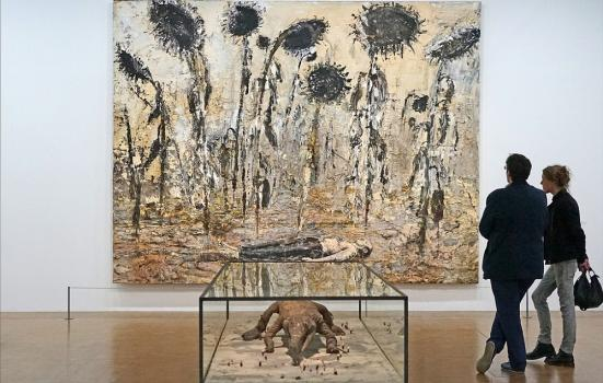 Couple viewing a painting and sculpture by Anselm Kiefer