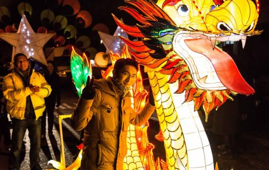 Photo of man with giant dragon lantern