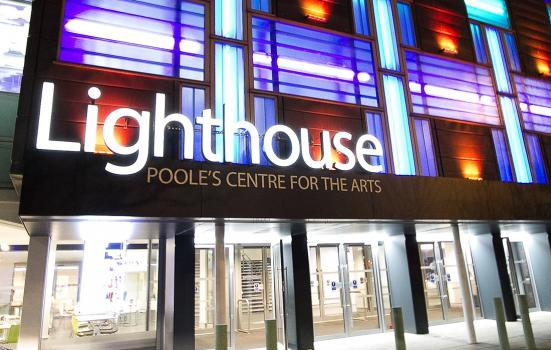 Poole's Lighthouse venue floodlit at night
