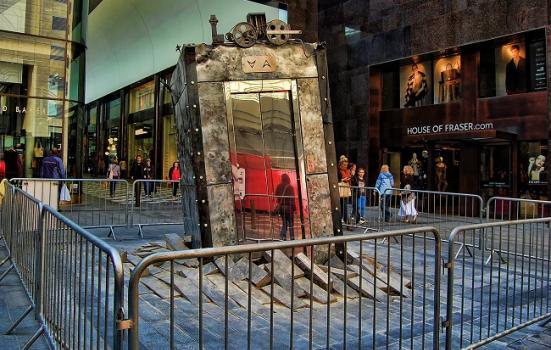 Photo of an artwork - a lift bursting through a pavement