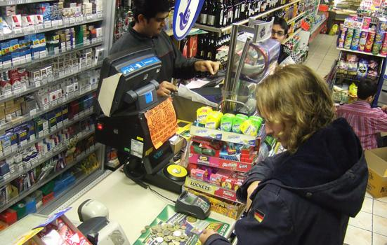woman buying a lottery ticket in a shop