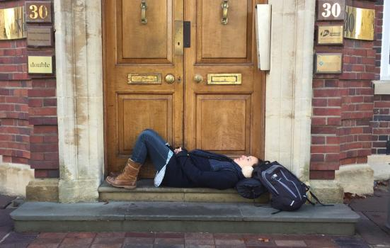 Photo of woman lying on a doorstep