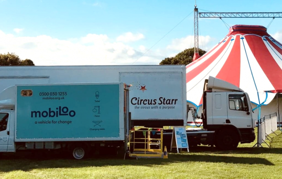 Photo of mobiloo outside circus tent