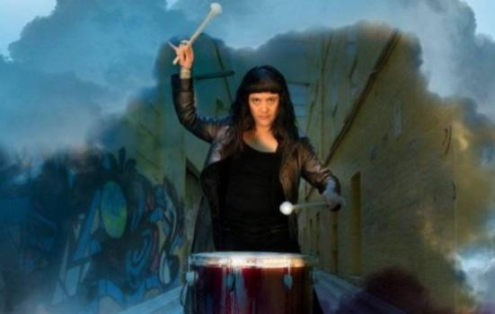 Phtoto of woman beating a drum