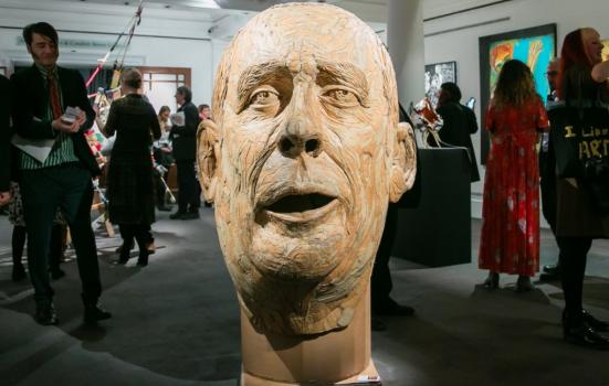 Photo of sculpture of large head in gallery