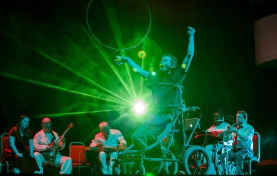 Photo of dancer and disabled musicians