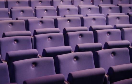Photo of purple auditorium seats