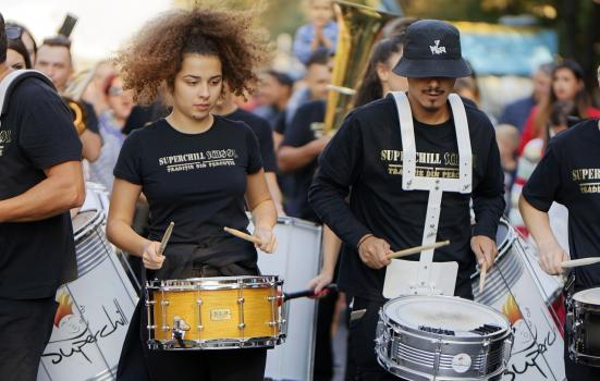 A photo of a group of young people playing percussion