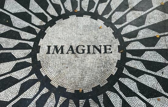 black and white mosaic pavement with the word 'Imagine' set in black
