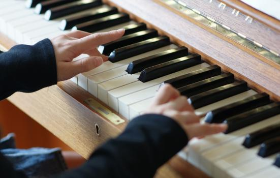Photo of hands playing piano