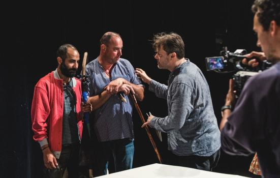 Photo of three people acting with cameraman