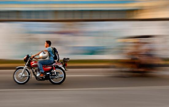 Photo of a motorcycle overtaking a bike