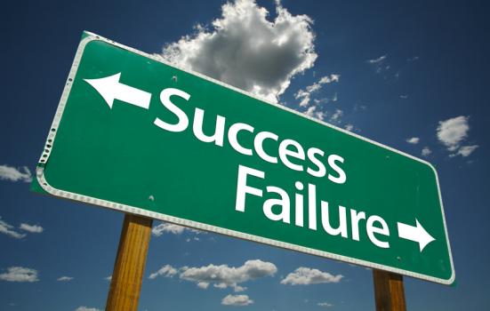 Image of a signpost pointing to success and failure