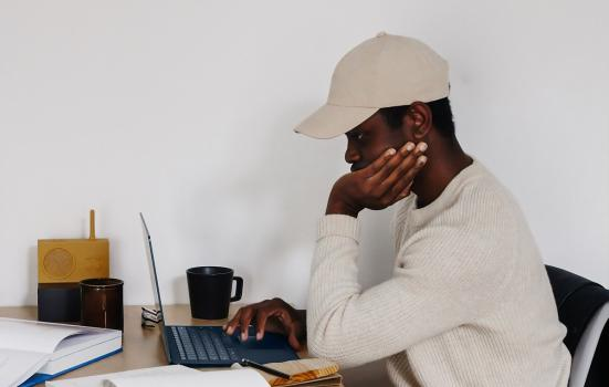 Man sitting at a laptop