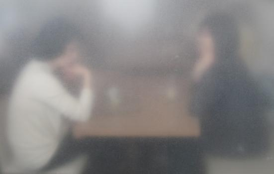 Blurry image of people talking