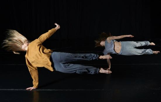 Photo of two dancers, horizontal