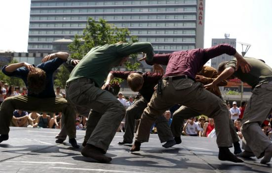 Photo of men dancing in city square