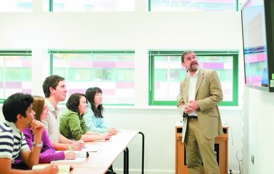 Photo of man lecturing to students