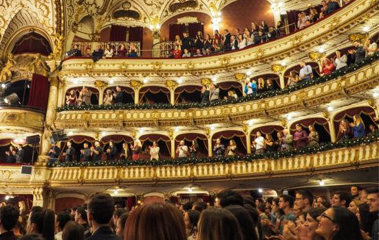 Photo of a standing ovation in a large theatre