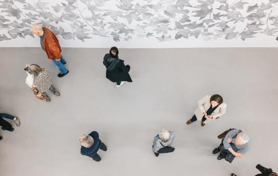 An overhead photo of people in an art gallery