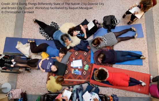 People laying on the floor working collaboratively