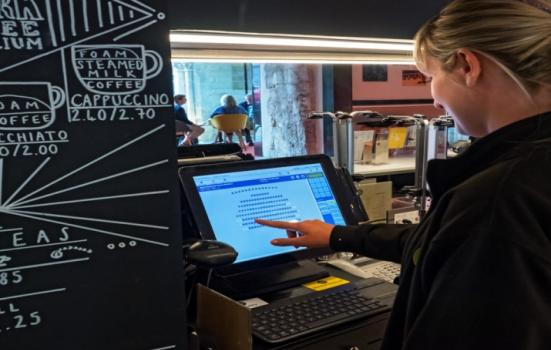 Woman using ticketing system on screen