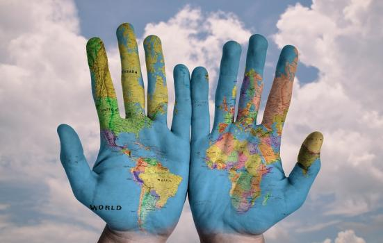 Hands with globe on
