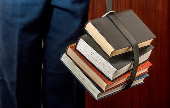 Man carrying books