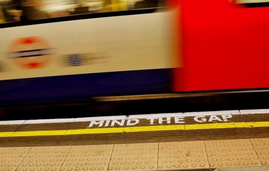 Underground station platform showing words 'mind the gap'