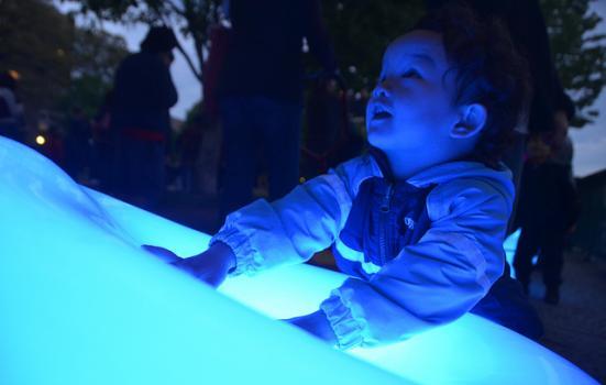 Photo of a boy looking at a Light Drift orb
