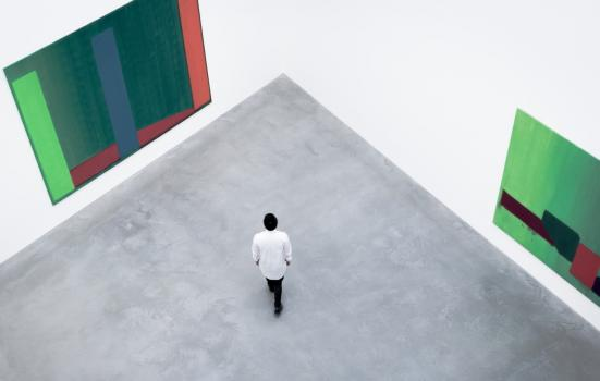 Photo of man in empty gallery