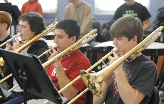 Photo of young people practicing trombone