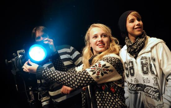 Photo of young people operating lighting