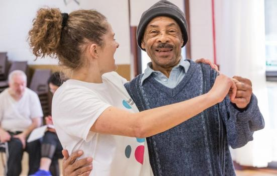 Photo of woman in dance hold with older man
