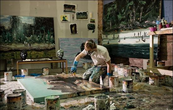 Man painting in artist studio