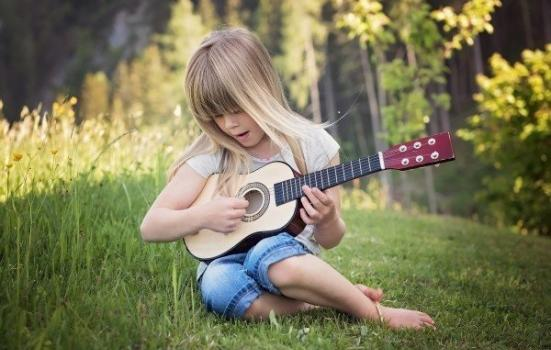 Photo of child playing music
