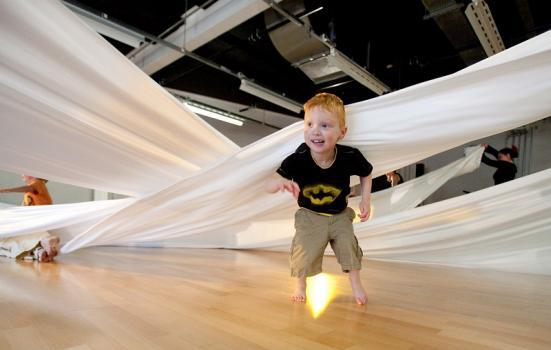 Photo of toddler under a sheet