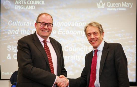 Darren Henley and Professor Simon Gaskell shaking hands