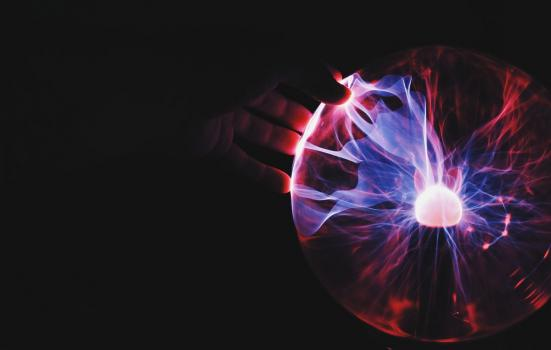 Hand on plasma ball lamp