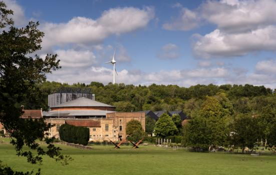 Glyndebourne Opera House with its wind turbine in the background
